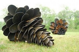 Giant pine cones made from shovel heads.