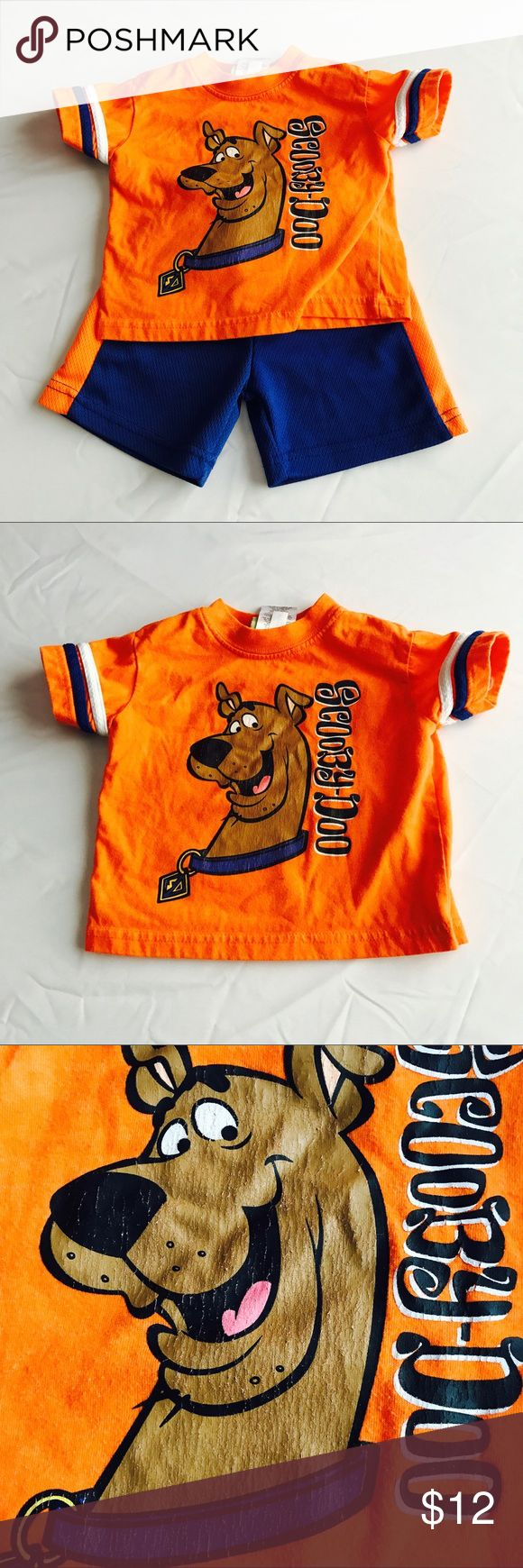 Scooby Doo Orange Blue Shorts Set 12m Scooby Doo Orange Blue Shorts Set 12m Great condition some wear on decal see pics 4 oz Scooby Doo Matching Sets