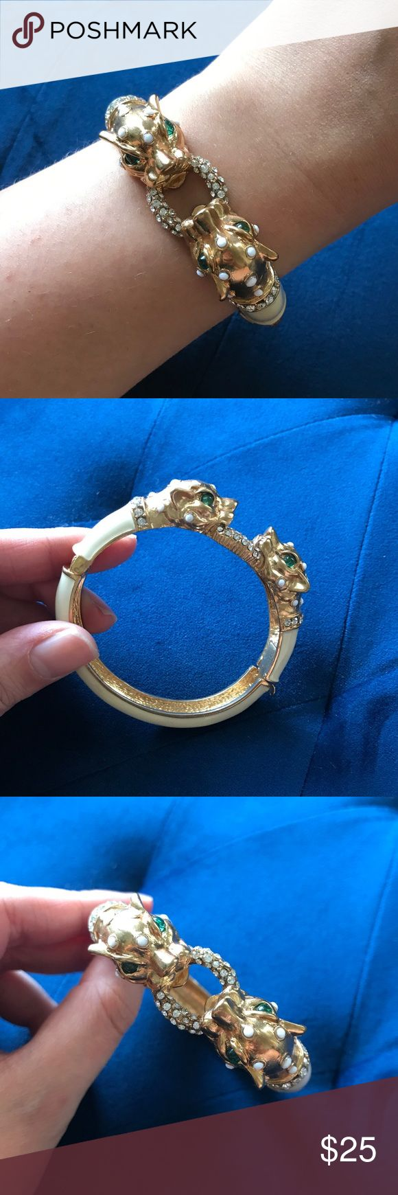 J.Crew Cat Bangle Bracelet Fun cat bangle bracelet from J.Crew. Cream enamel with white and green accents. Hinged clasp to make getting the bracelet on and off easy! Very good pre-loved condition. 🛍BUNDLES ALWAYS GET 20% OFF🛍❌NO TRADES❌NO LOWBALL OFFERS❌ J. Crew Jewelry Bracelets