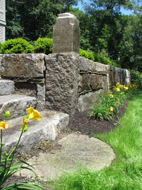 Granite Block Curb : Retaining wall with stairway built from reclaimed granite