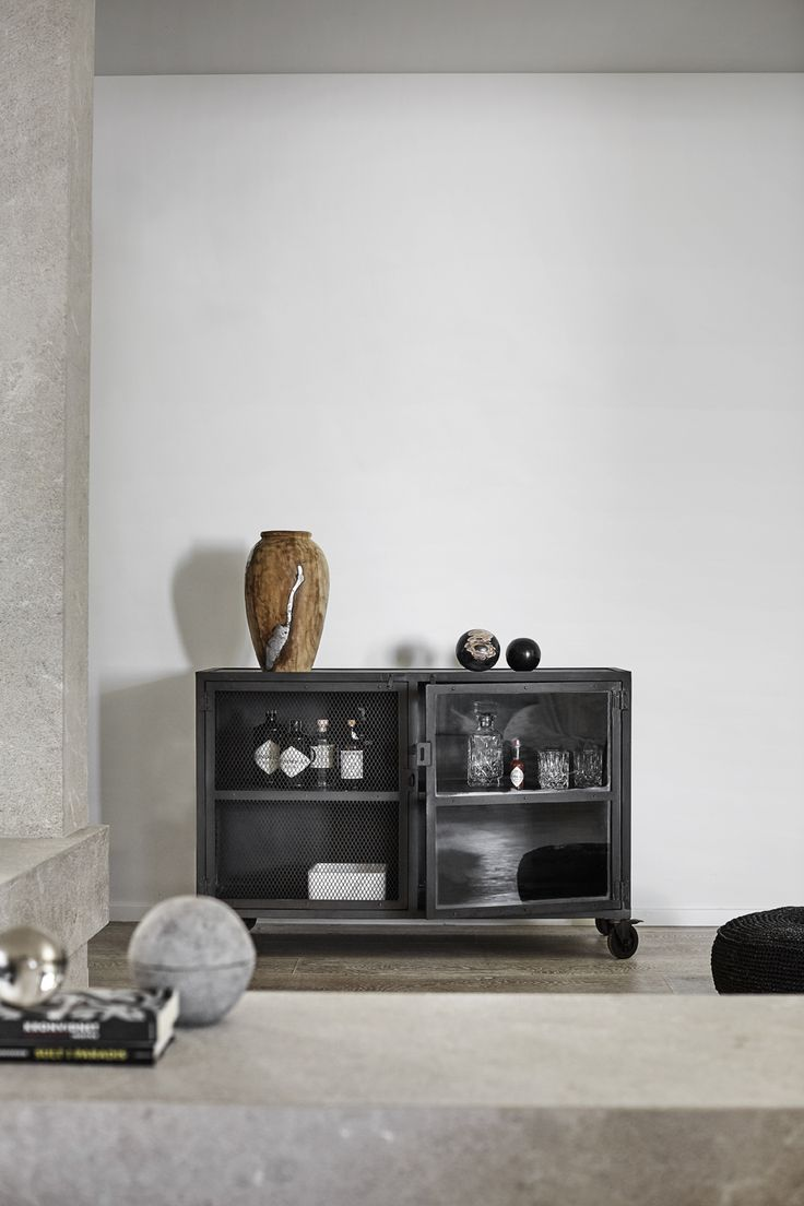 Iron cabinet with wheels from Muubs. The cabinet can be used as a bar cabinet. Use also the iron cabinet for books or for example your glasses and plates.