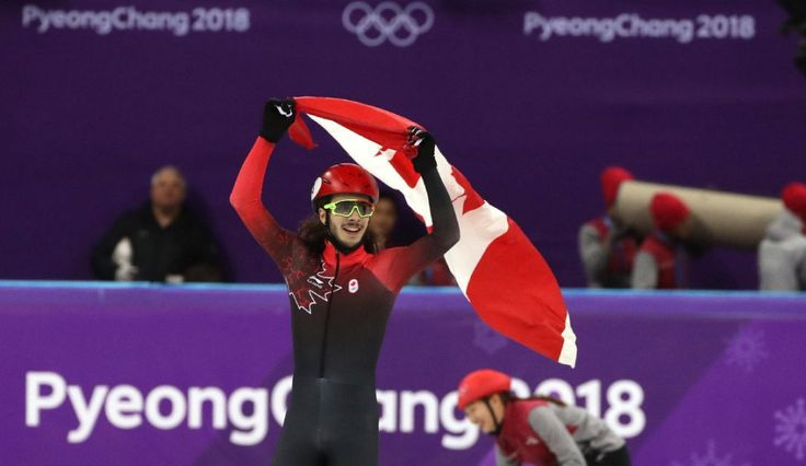 Samuel Girard celebrates his gold-medal win in the men's 1,000 metres in short-track speed skating.