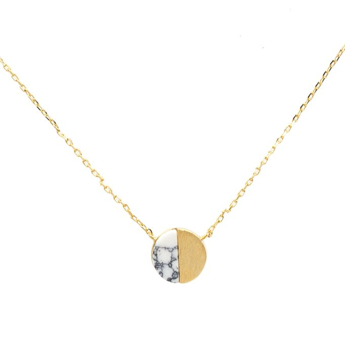 """Half marbled stone, half shining gold beauty, this pendant means you can have a little lunar style with any outfit. Dimensions: Chain measures 16"""" in length. Details: Gold plated. Natural stone."""