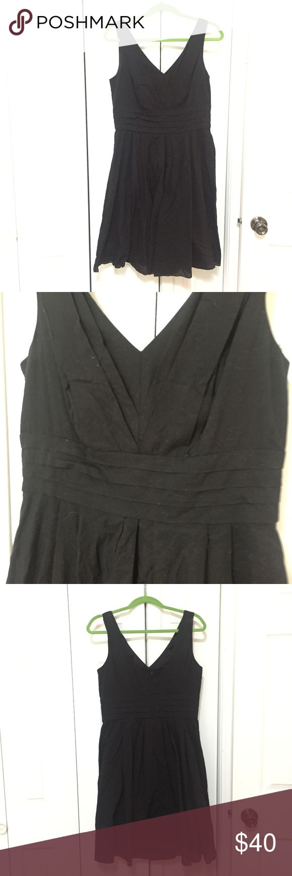 "WHBM Little Black Dress Super cute black dress with pleating on the front and back bodice, with a full gathered skirt, and pleated waist. Good condition, reasoning is I washed instead of dry cleaned which was the recommend cleaning. V-neck front, squared back neck line. Cotton like material. Hits below my knees, and I'm 5'6"". White House Black Market Dresses Midi"