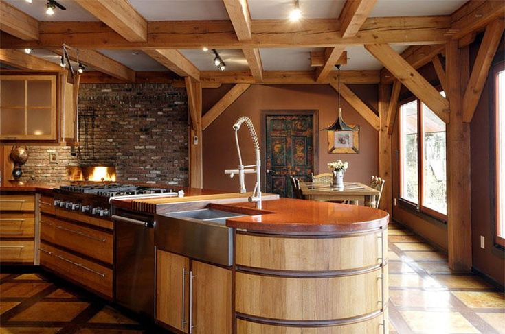 Rustic timber frame kitchen with modern flare and concrete countertop on center island, Interior Design Arts,