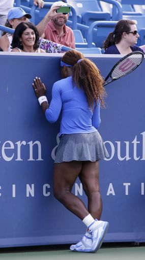 Serena Williams leans against the wall after missing a shot against Victoria Azarenka, from Belarus, during the finals match at the Western & Southern Open tennis tournament on Sunday, Aug. 18, 2013, in Mason, Ohio. Azarenka won 2-6, 6-2, 7-6 (6). (AP