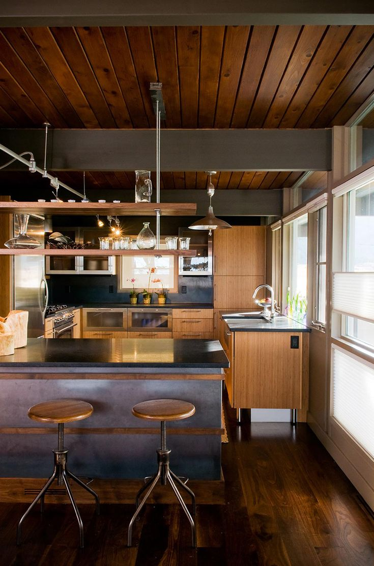 This rustic mid century home by Pearson Design Group is a perfect mix of mid century and rustic industrial. The home started as a 1960 1,200 square foot