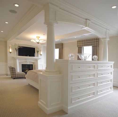 Use a dresser as a headboard and room divider