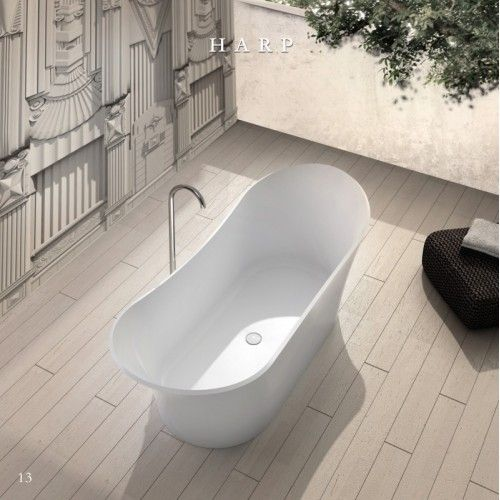 """The Harp Solid Surface Stone Tub's striking 69"""" tub size and high quality elegance is fit for royalty. The Harp double slipper tub is a Victorian style tub with a classic high back on both ends providing full body support and ultimate comfort. The stone resin tub is luxurious and spacious making it ideal for the perfect deep soak experience for two. With beautiful natural contours and class leading interior space, the Harp solid surface tub is a triumph of elegance and functionality."""