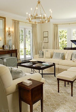 Good way to work four stool inot a narrow room for extra seating.  Like the small French side tables and big coffee table.  Notice no fireplace and no lamps; console with mirror and sconces stand in for fireplace and chandelier for lighting. Oh well they did sneak in a grand piano.