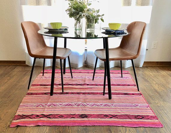 54 inches x 53 inches Frazadas are vintage textiles that we sourced from markets across the Cuzco region of Peru. Every piece is one of a kind, made from wool, dyed with natural colors. Each piece is hand-loomed in two separate parts and then sewn together. Frazadas make great