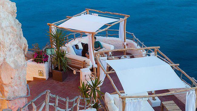 Coolest bars in the world - includes Cova den Xoroi  in Menorca, Soain. Of course!