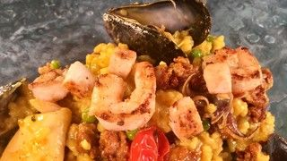 Paella with Chorizo, Shrimp, Calamari, Mussels, Green Peas, and Curry Butter Recipe | The Chew - ABC.com