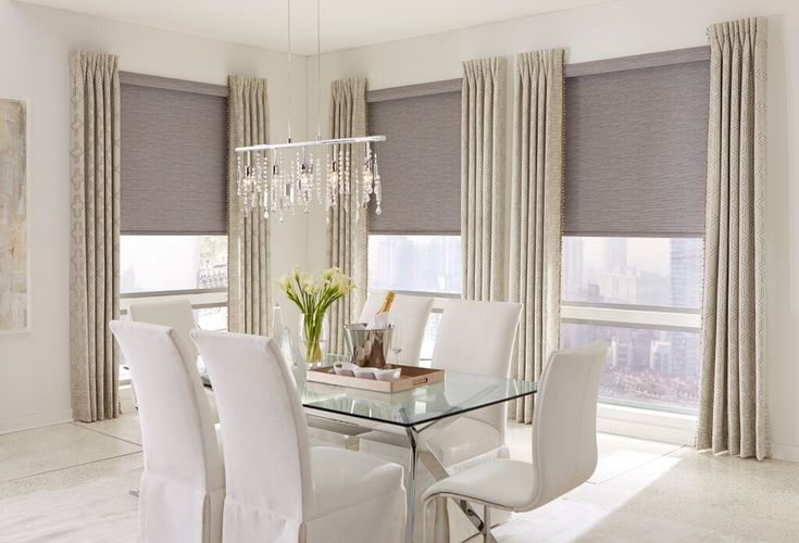 "Shades of Elegance: roller shades in ""strings blackout slate"" pattern with a cassette valance and inverted pleat side drapery panels."