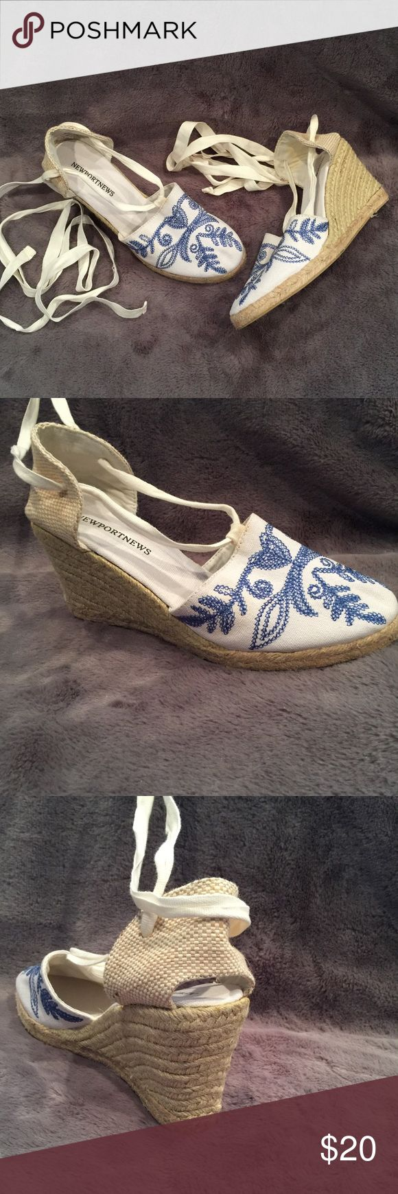 Lace up wedges Newport News high heels. Brand new. White and blue embroidered closed toe platforms. Has a nautical theme to it with roping around the heel. Has long straps to lace up or wrap around the leg. Small hole in the heel for a little sexy look. Newport News Shoes Espadrilles