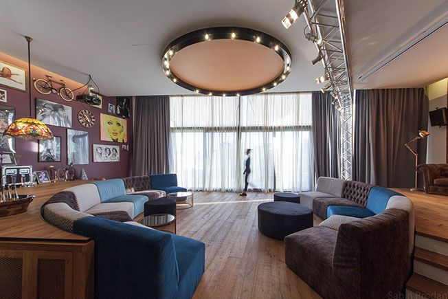 Open plan living with circular sofas, Backstage concept - Apartment M, Bucharest