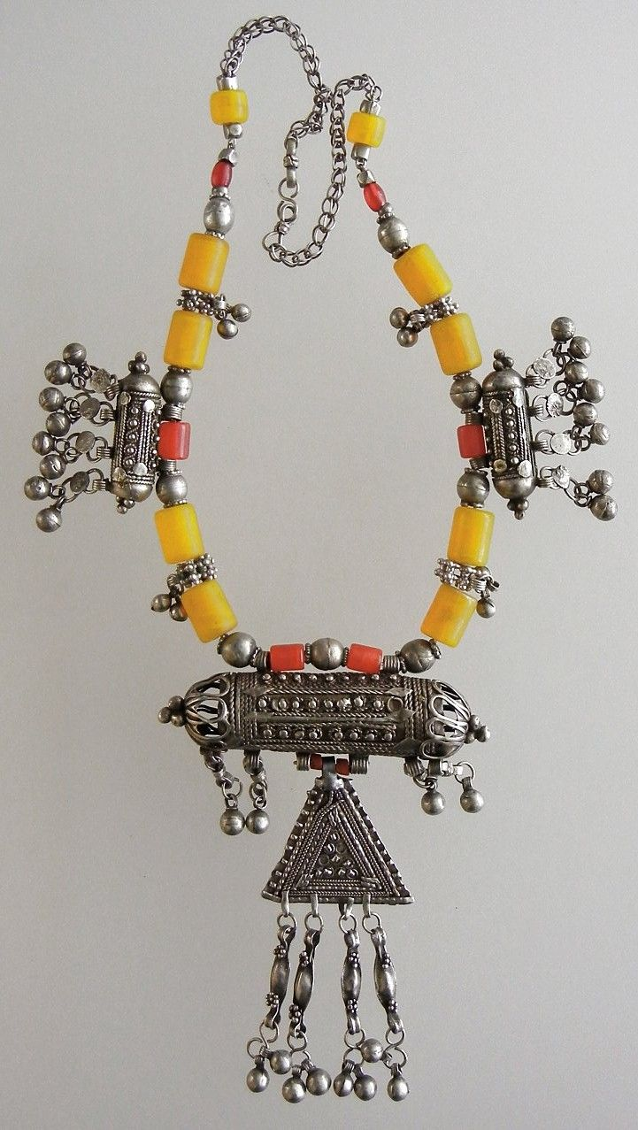 Yemen | Silver combined with resin coral and amber intimation beads.