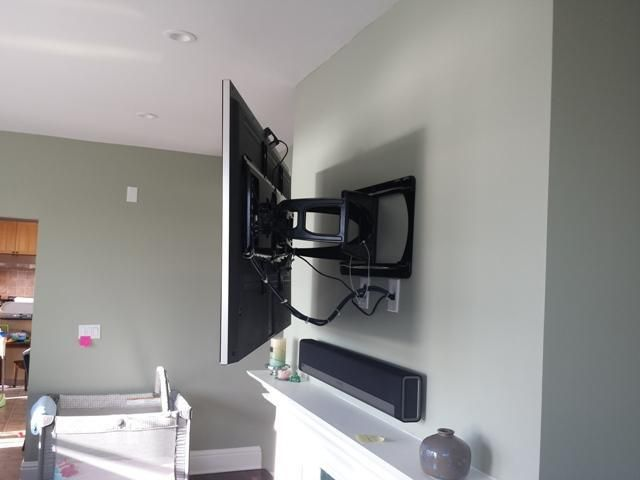 heavy duty motion bracket over fireplace with the SONOS sound system
