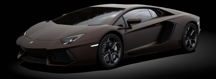 Lamborghini LP700-4 Adventador  Maronne Apus (matte brown) with black and Green interior.  Chosen for the V12 soundtrack, scissor doors, and used as a night driver