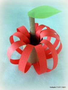 apple or pumpkin made with paper strips and toilet paper tube.