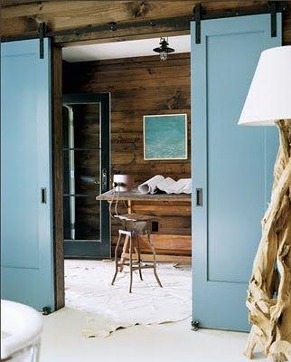 work space_drafting table chair natural industrial wood sliding panel doors metal track colonial ocean blue_meyer davis studio