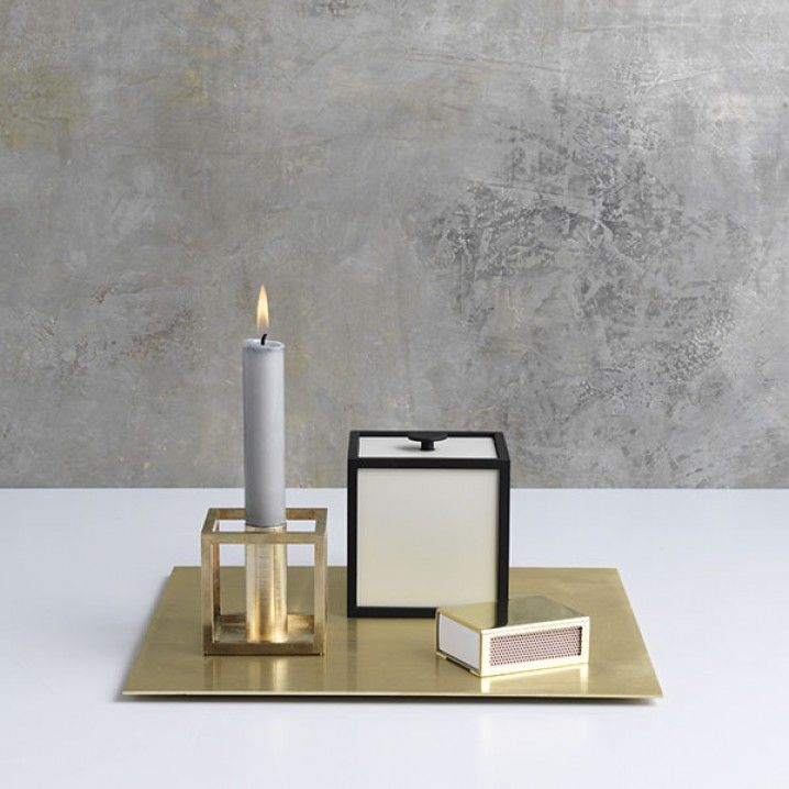 With a sharp sense of contemporary Functionalist style, Mogens Lassen designed the iconic Kubus candle holder in 1962, a piece once reserved solely for family and close architect colleagues. The Kubus is still crafted in Denmark, and among architects and design connoisseurs it has achieved the status of a modern international design icon.   Measurement: 7x7 cm Colour: Brass Material: Lacquered steel