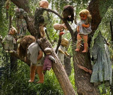 Isla de las Munecas. The trees of this island near Mexico City are strung with hundreds of dolls. The island's only inhabitant, Don Julian Santana, discovered the body of a girl in one of its canals more than 50 years ago. He found a doll floating in the same water and, in tribute, hung it on a tree—the first of thousands he would string up until 2001, when he drowned in the same canal. Some believe the dolls, are evil; others believe they safeguard the island.
