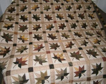 ORDER YOUR Autumn Splendor quilts which will only be made by Elizabeth S who has been making this pattern for over 20 years. All the colors of Autumn was used in making this beautiful quilt. The quilt