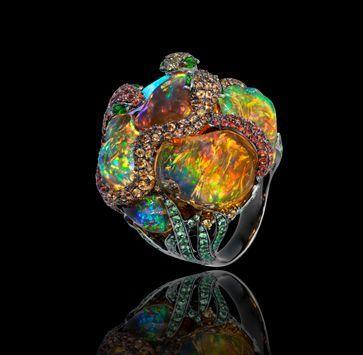 "Lydia de Courteille, ""Jardins de Xochimilco"", snake ring, blackened white gold, rubies, sapphires, tsavorites, diopsides, Mexican fire opals."