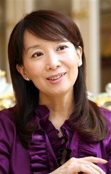 agnes chan - professor, novelist, singer, essayist, UNICEF ambassador, a Doctor in Education, a loving mother.