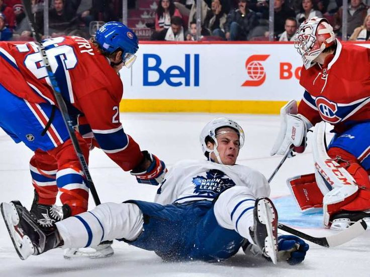 Jeff Petry (26) of the Montreal Canadiens takes down Auston Matthews (34) of the Toronto Maple Leafs during the NHL game at the Bell Centre on Saturday, Oct. 29, 2016, in Montreal.