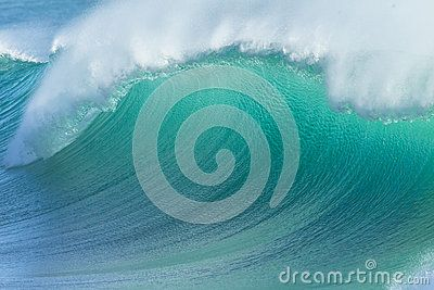 Ocean wave closeup detail of upright crashing hollow breaking water energy power of nature