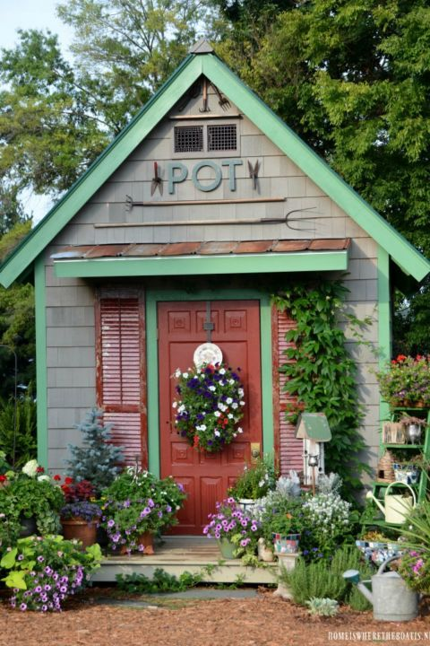 """Cozy """"She"""" Shed Blogger Mary used old letters and vintage garden tools to decorate the front of her gorgeous potting shed."""