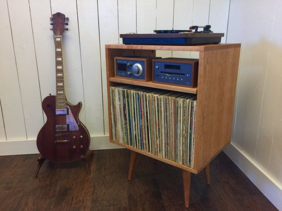 Micro mid century modern record player console, stereo cabinet with LP album storage. Avail in cherry, white oak or mahogany.