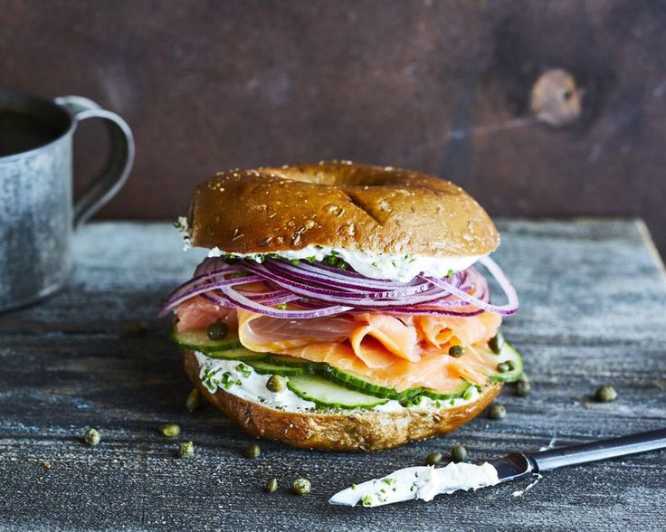 Starting with smoked salmon, this bagel sandwich is layered with tasty ingredients—flavored cream cheese, capers, and purple onion. It's...