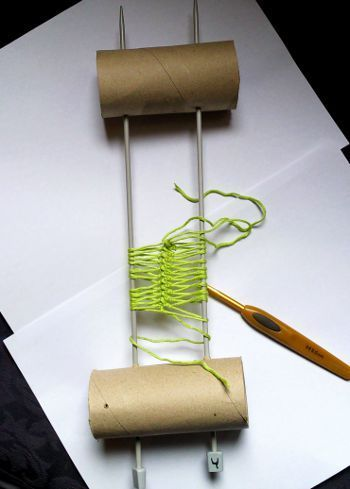 Clever homemade Hairpin #Crochet Loom using 2 knitting needles and a paper towel roll. I have a couple of Hairpin Crochet Looms, but this is a great way to make a custom sized one. For example, I 'd love to have one for lace weight threads.