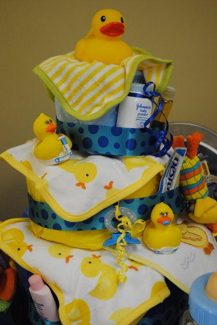 """SPLISH! SPLASH! Check out this adorable rubber ducky baby shower hosted by Morgan Lea for her sister-in law. I love this idea! The rubber duckies are so cute floating in the blue/green punch!! Your guests will go """"quackers"""" over this amazing cake! From the inspired words of Ernie of Sesame Street, """"Rubber Ducky, you're the ...continue reading"""