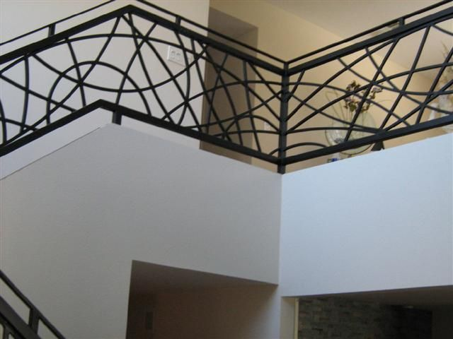 Interesting contemporary iron balustrade pattern...