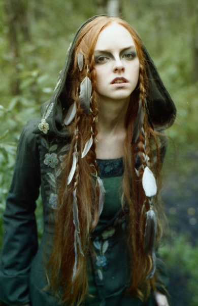 She creeps me out but I like the feathers in her hair. o_O