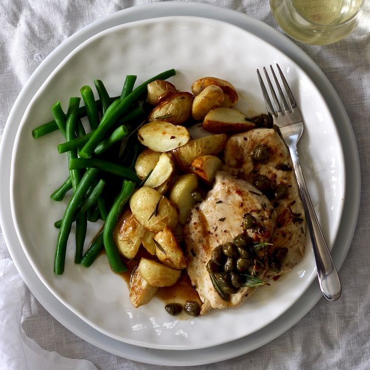 CHICKEN, WHITE WINE AND CAPER SAUCE WITH ROAST POTATOES & GREEN BEANS. Succulent chicken breast topped with a white wine and caper sauce, served with roasted rosemary chat potatoes and green beans. If you are looking to impress someone special then this is a great dish to pull out... Easy. 30 Minutes. A great dish any night of the week.
