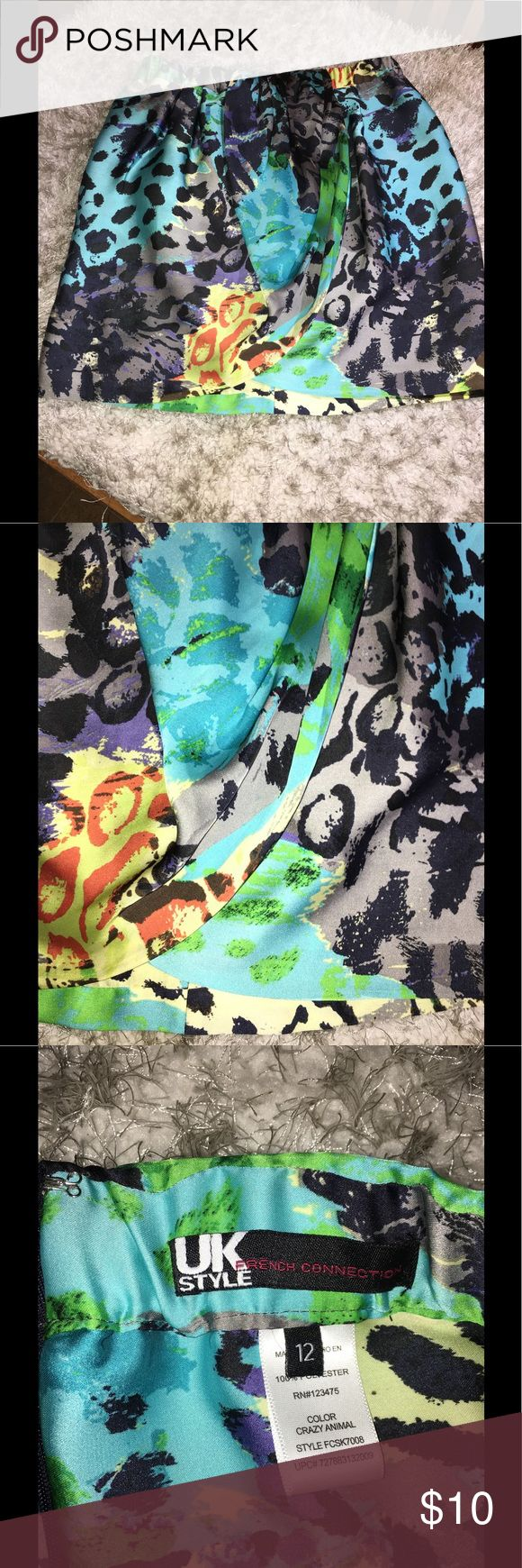 French Connection Satin Faux Wrap Skirt Size 12 Satin skirt by French Connection. Multi color print called crazy animal. Front has a wrap inspired style.  Size 12. Skirt is 18.5 inches long.   Great condition. Important:   All items are freshly laundered as applicable prior to shipping (new items and shoes excluded).  Not all my items are from pet/smoke free homes.  Price is reduced to reflect this!   Thank you for looking! French Connection Skirts Mini