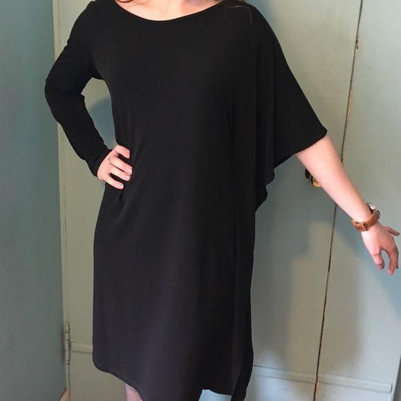 Black tunic dress USA made! Stunning black tunic dress by Clara Sun Woo. One arm long, one dolman. Fabric accent down side. Runs large. Clara Sun Woo Dresses Midi