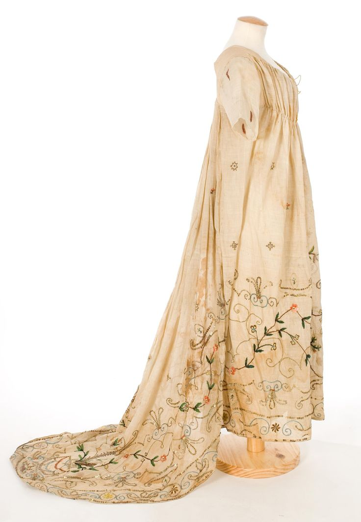 Dress: ca. 1790-1815, cotton muslin decorated with sequins, metallic applications and feathers; embroidered. Search for 11450.