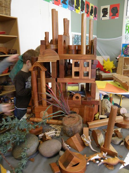 Many different blocks, stones, stumps, rocks etc used together to create a fun play area in the classroom - be careful if the tower falls down! Wonderful idea.