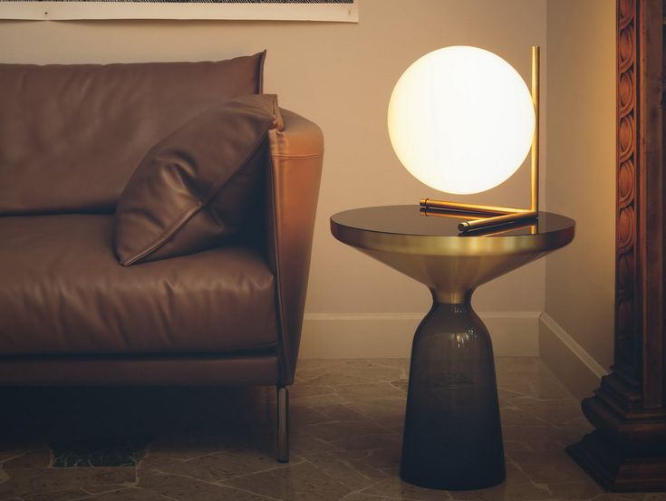 Flos IC TABLE LIGHT LOW (Michael Anstassiades, 2013) on a BELL Side Table (Sebastian Herkner, 2012) for ClassiCon next to a GENTRY Leather Sofa (Patricia Urquiola, 2010) for Moroso.