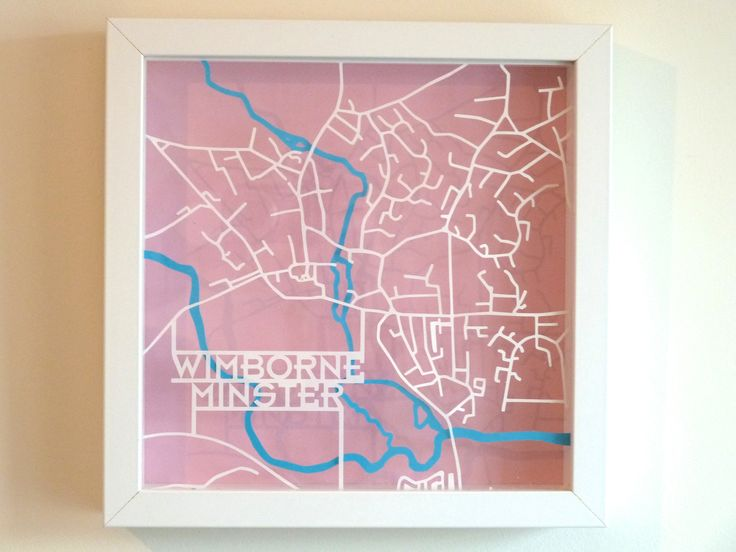 Multi-layered papercut of a map of the town of Wimborne Minster in Dorset by Graham Palmer © 2013-15