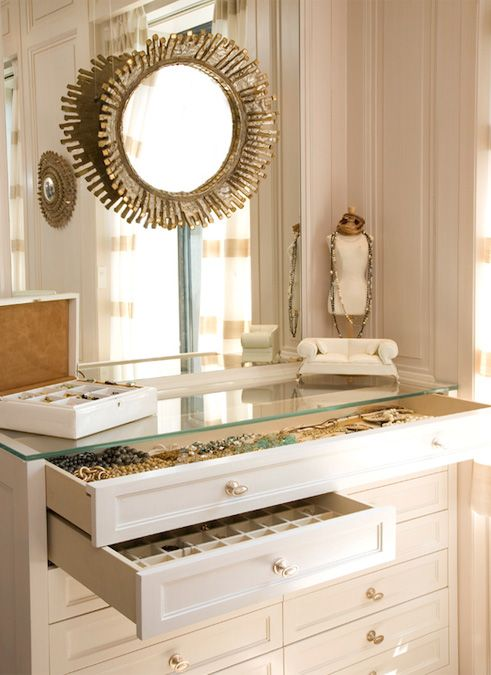 mirror over bureau and jewelry in master closet