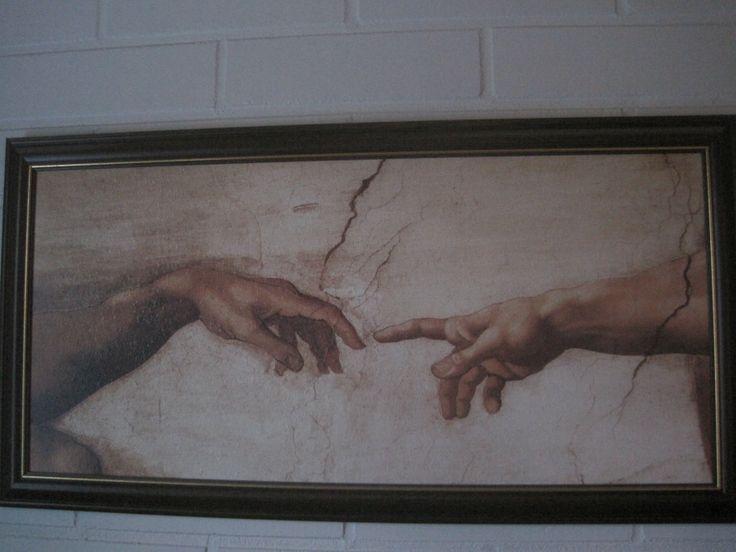 Taulu: pieni yksityiskohta maalauksesta Michelangelo/Aatamin luominen