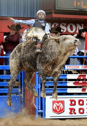 Bull Ride - Sean Case takes a high ride on Claim Jumper during the bull riding at the Fiesta de Los Vaqueros Feb. 27 , 2010 at the Tucson Rodeo Grounds. Photo by James Gregg/ Arizona Daily Star