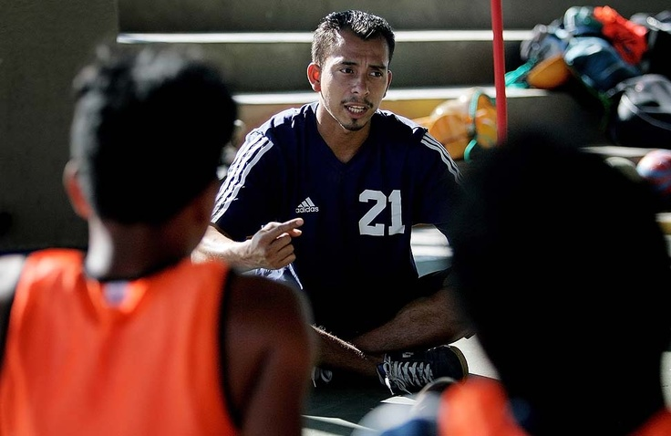 LOS ANGELES — LOS ANGELES, CA - JULY 25, 2010: Coach Johny Figueroa speaks to members of the team after their second to last practice before they depart for Washington, D.C., to participate in the Street Soccer USA Cup. (Katie Falkenberg / For The Times)